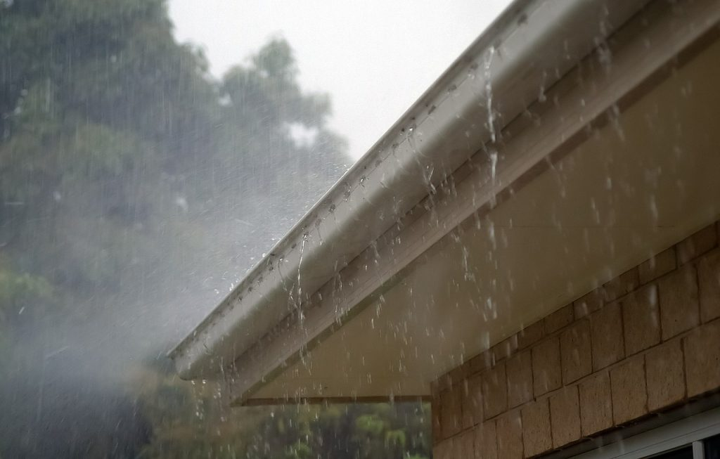 can you shingle a roof in the rain
